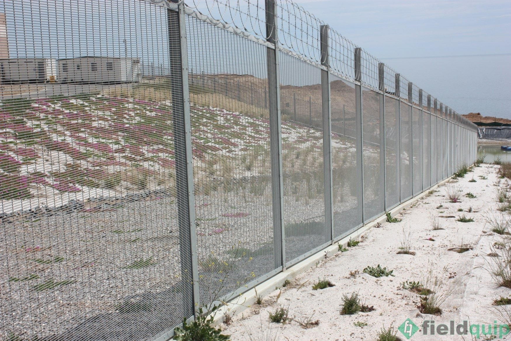 1. 358 mesh security fencing with barbed wire top. - Fieldquip