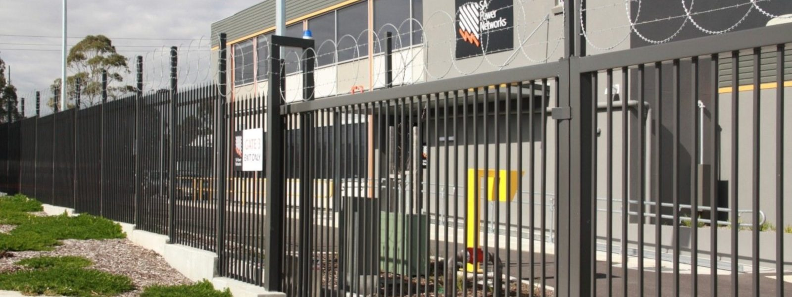 Automated Large Gate topped with barbed wire and razor rings at SA power networks