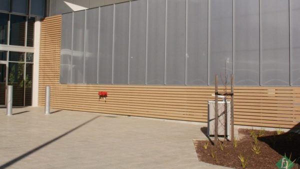 Architectural screening attached to timber with bollards in ground